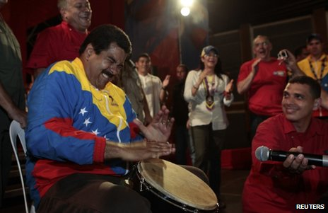 Nicolas Maduro plays a drum while on the campaign trail in the state of Bolivar, Venezuela, 6 April