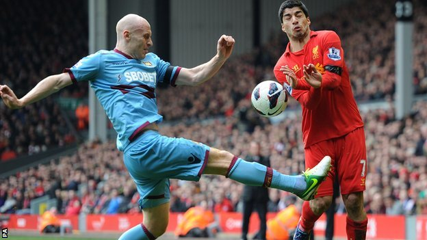 West Ham defender James Collins (left) foils Liverpool striker Luis Suarez