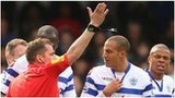 QPR striker Bobby Zamora reacts after his red card
