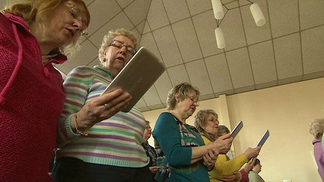 Churchgoers using hand-held computers