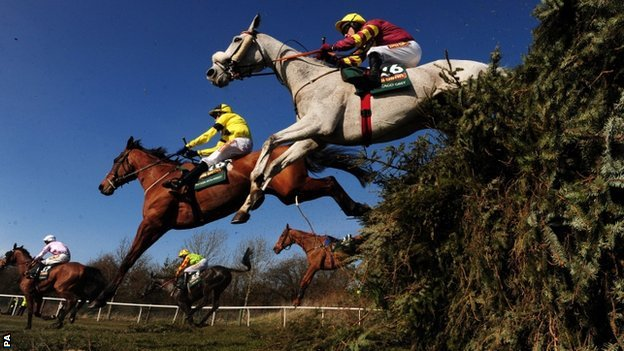 Horses contest the 2013 Grand National at Aintree
