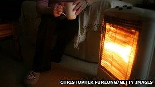 Woman sat next to heater