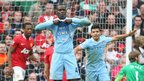 Mario Balotelli celebrates scoring a goal