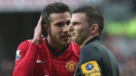 Robin van Persie with referee Michael Oliver