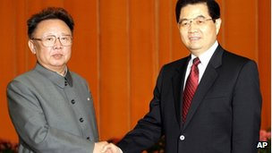 Chinese President Hu Jintao, right, shakes hands with North Korean leader Kim Jong Il, left, at Beijing's Great Hall of the People on Tuesday January 17, 2006.