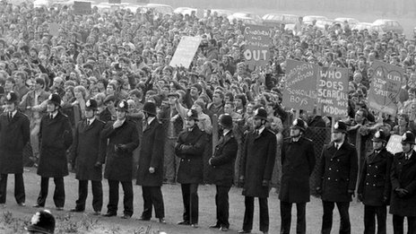 "lines of policemen dividing the two factions involved in a ""Right To Work"" Rally by miners at the Nottinghamshire NUM Headquarters, Mansfield, during the year long miners strike of 1984."