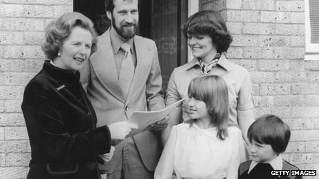Margaret Thatcher hands over the deeds to the council house belonging to the King family of Milton Keynes, Buckinghamshire, 25th September 1979.