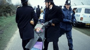 Police drag a woman protester at Greenham Common