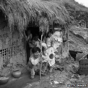 A family cowers in Chorwan during the Korean War