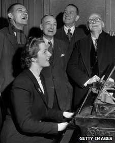 Margaret Thatcher in Dartford 1950 with four men watching her playing the piano