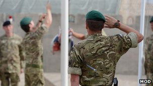 Marines lower the flag at their base in Afghanistan for the final time