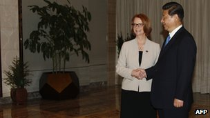 China's President Xi Jinping shakes hands with Australia's Prime Minister Julia Gillard