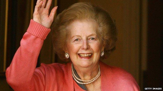 Baroness Thatcher waves from a doorway