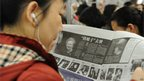 A woman reads about the news of former British prime minister Margaret Thatcher's death in a Chinese newspaper in Shanghai on 9 April 2013.