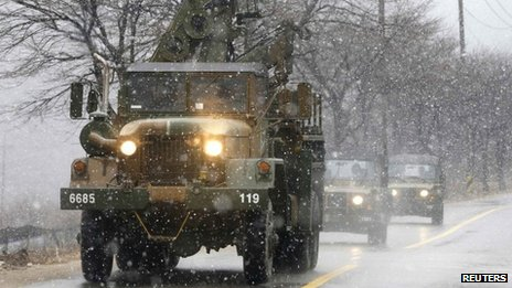South Korean military vehicles travel during a drill as it snows in Hwacheon, about 20 km (12 miles) south of the demilitarized zone separating the two Koreas