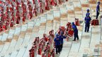 Workers install seats at Brasilia's National Stadium