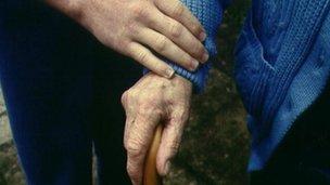Helping hand on elderly person
