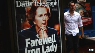 A man walks by a display of the Sydney tabloid newspaper the Daily Telegraph marking the death of former British Prime Minister Margaret Thatcher in Sydney on Tuesday