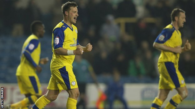 Chris Maguire celebrates (second left)