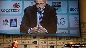 Uefa general secretary Gianni Infantino in conversation at the Soccerex football finance conference