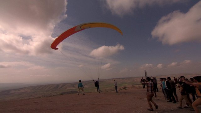 A paraglider sets off outside Mosul