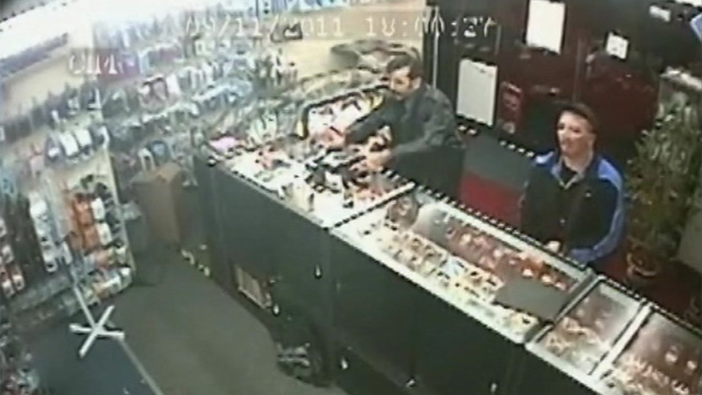 CCTV of Mr Jawaid delivering mobile phones