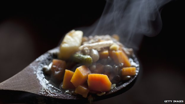 Steaming food on a wooden spoon