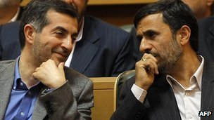 The picture taken on April 14, 2009 shows Iranian President Mahmoud Ahmadinejad sitting next to his aide Esfandiar Rahim Mashaie as they attend the Iranian expatriates summit in Tehran.