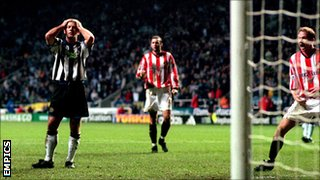 Alan Shearer looks on as Thomas Sorensen saves his spot kick