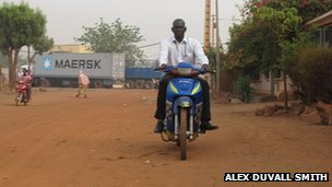 A man on a motorbike in Bamako