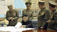North Korean leader Kim Jong-un (seated) discusses strike plan with North Korean officers during a meeting at the Supreme Command in an undisclosed location (image released by state media on 29 March 2013)