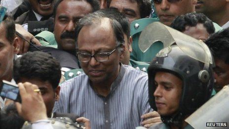 Police escort Mahmudur Rahman to court in Dhaka