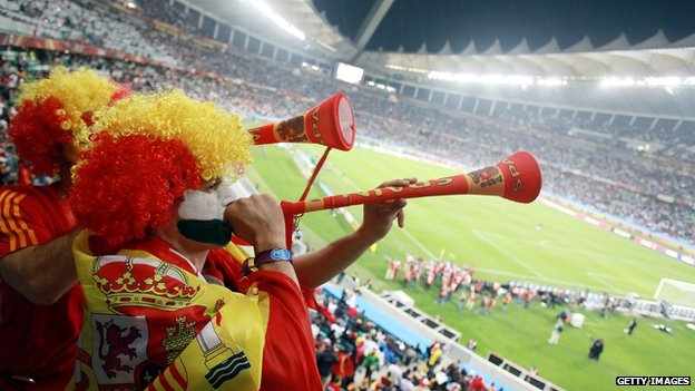 Spanish fans blow vuvuzelas during the 2010 World Cup