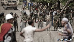 Egyptian anti-military protesters confront army troops during a protest outside the defence ministry on May 4, 2012