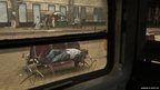 A man lays down as he waits hours in Cairo for a train