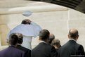 Pope Francis's skull cap is blown away in a gust of wind in St Peter's Square