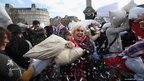 Revellers take part in a giant pillow fight in Trafalgar Square on International Pillow Fight Day in London