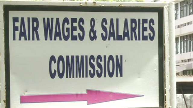 A sign reading Fair Wages & Salaries Commission