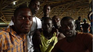 Group of immigrants from Senegal waiting for their visas