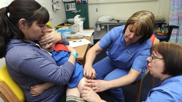 Rowan Walters is given the MMR jab at a drop-in clinic in Swansea