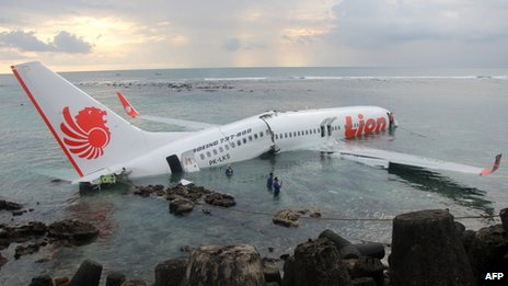 The crashed jet lies in water near Denpasar airport, Bali, 13 April