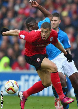Cardiff substitute Rudy Gestede is challenged by Forest's Guy Moussi