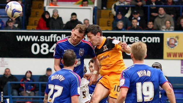 Hull midfielder Robert Koren heads in his side's winner against Ipswich