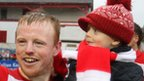 George McMullan with his son Cillian as the celebrations continue at Solitude