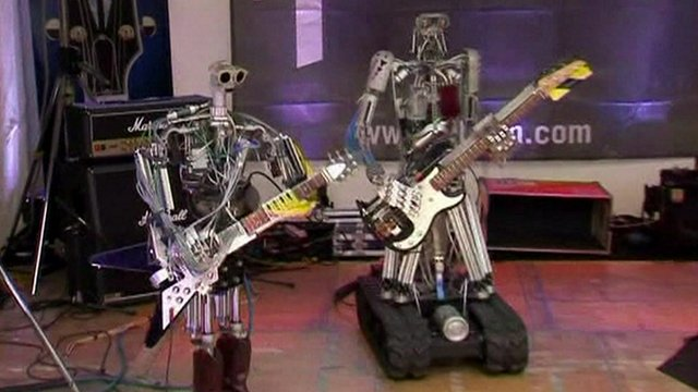 Compressorhead's guitarist, Fingers, and bassist, Bones