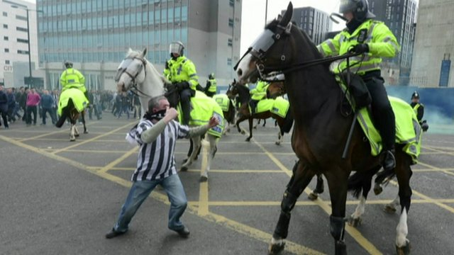 Football fan and policemen on horseback