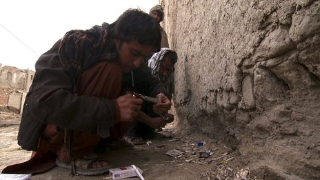 Hashmat, 22, smokes opium on the streets of Kabul