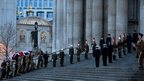 Representatives from the three military services line the steps of St Paul's Cathedral as they take part in a rehearsal for the ceremonial funeral of former PM Margaret Thatcher