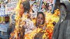 Anti-North Korean protesters from conservative, right-wing and pro-U.S. civic groups, burn effigies of late North Korean leader Kim Jong-il (R), current leader Kim Jong-un (2nd R) and the North's founder Kim Il-sung during a protest in central Seoul April 15, 2013.