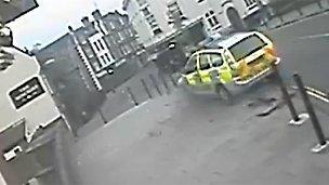 Police car crashing through roadside bollards on Fye Bridge